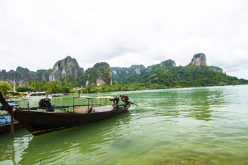 Traditional thai boats at the beach of Krabi