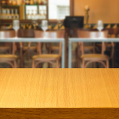 Empty wooden modern table inside restaurant, bar or coffee shop