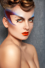 Beauty adult girl with color make up looking at camera