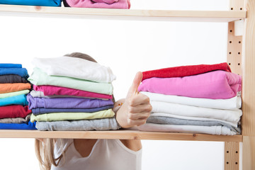 young woman and shelf with clothing