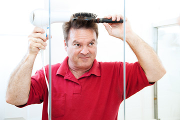 Man Blow Dries Hair