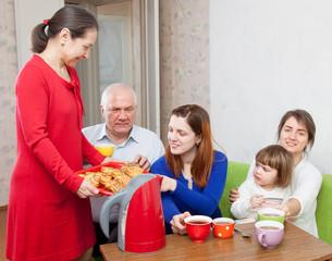 happy  family communicate over tea