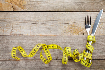 Measure tape with knife and fork. Diet food