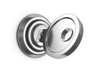 metallic key in lock on white background