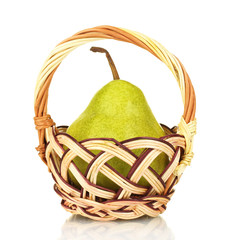 Fresh pear in wicker basket isolated on white
