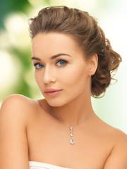 woman wearing shiny diamond pendant