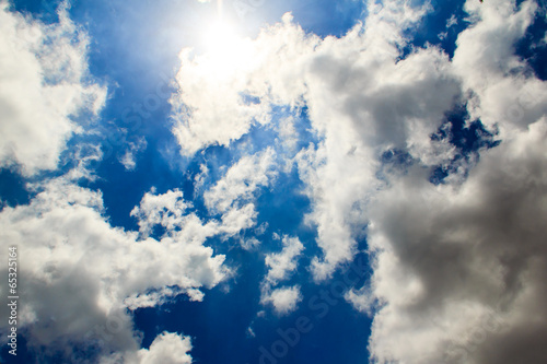 bright clouds with blue sky ,sun rays