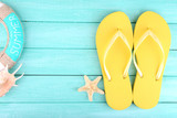 Fototapety Bright flip-flops on color wooden background