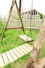 Old wooden swing in the park
