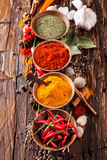 Various spices on wood