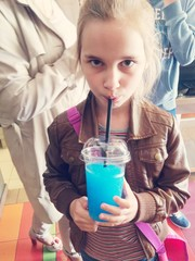 Girl drinking colourful cold drink