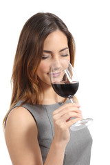 Beautiful sommelier woman tasting wine