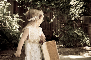 Vintage little girl looking backwards