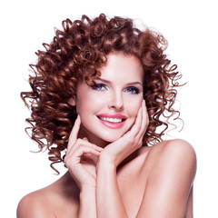 Beautiful happy woman with brunette curly hair.