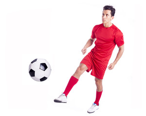Soccer player kicking the ball, isolated on white background
