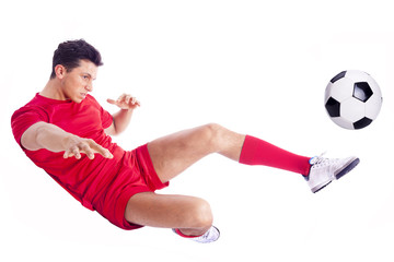 Soccer player making an acrobatic kick, isolated on white backgr