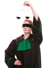 female lawyer in classic polish black green gown and scales