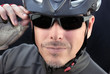 Friendly Bicycle Courier Puts On Sunglasses