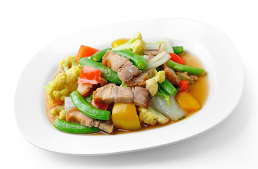 stir fried vegetables in the white plate