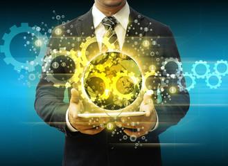 businessman holding tablet world technology social media and cog