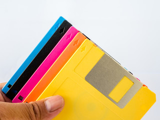colourful diskette on human hand