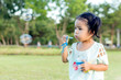 Asian baby girl playing bubble balloon