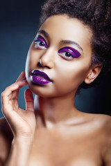 The portrait of beautiful young black girl in violet color