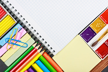 notepad for recording and various school supplies