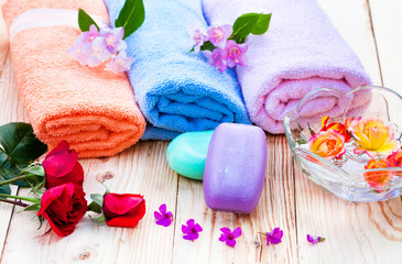 Spa set with towels and roses