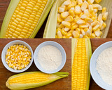 Corn and starch on wood table poster