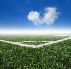 Soccer  grass field with blue sky