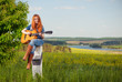 woman playing guitar at spring meadow