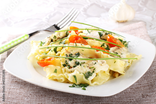 Pasta with seafood, tomatoes and chives