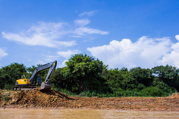 Excavator loading dumper truck tipper in construction site
