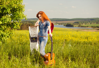 lonely woman with guitar at roadside milestone
