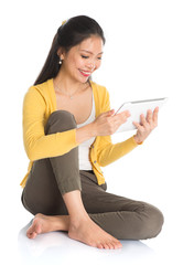 Asian girl using tablet computer