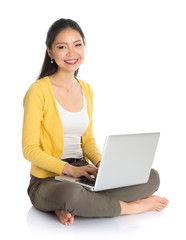 Asian girl using notebook computer