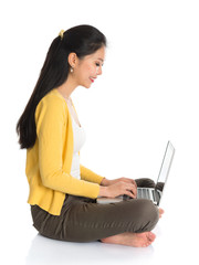 Side view Asian girl using notebook computer