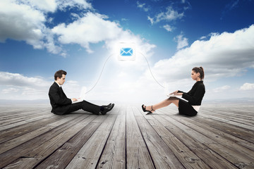 business girl and man mailing with with laptop