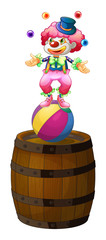 A clown juggling above the barrel