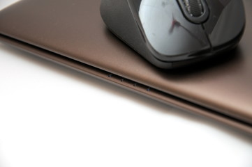 Bluetooth mouse on the chocolate laptop lifestyle