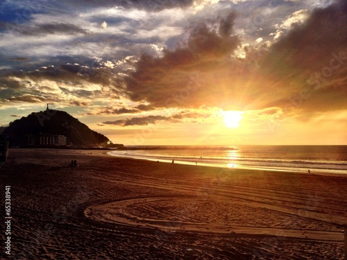 canvas print picture sunset at playa zurriola, san sebastian