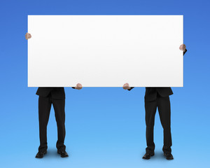 Two men holding blank board