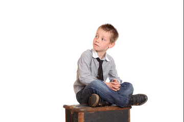 Young boy sat cross-legged