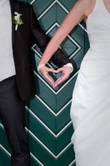 Herzhand des Brautpaares zur Hochzeit