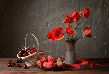 Poppy in a ceramic vase, cherries and strawberries