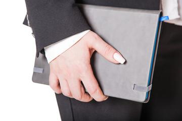 girl holds notebook