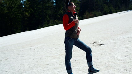 young woman standing on a ski slope