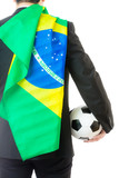 Back view of businessman holding soccer ball and Brazil flag