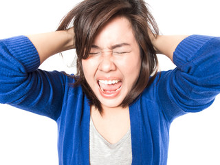 Young stress woman going crazy pulling her hair in frustration o